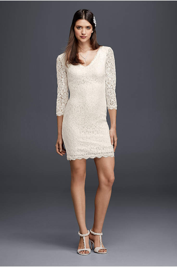 Short 3/4 Sleeved Lace Wedding Dress - Classic and modern details combine to create an
