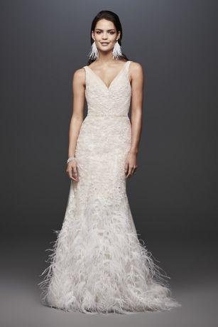 Lace Petite Mermaid Wedding Dress with Feathers - This dramatic mermaid wedding dress makes a statement