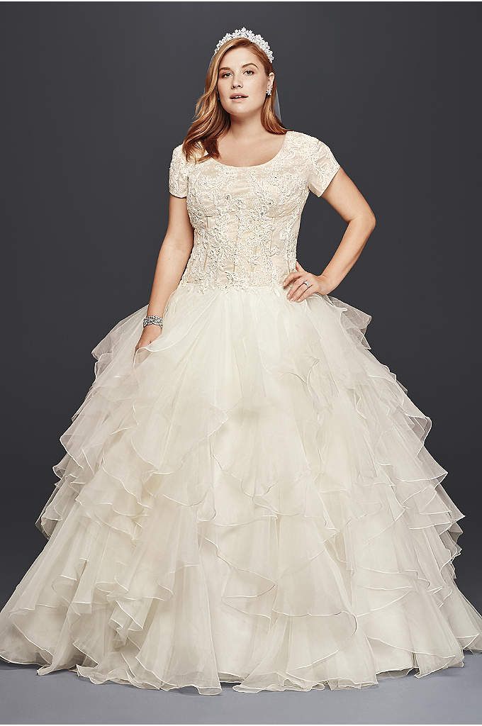 Oleg Cassini Plus Size Modest Ruffle Wedding Dress - This modest plus size ball gown is both