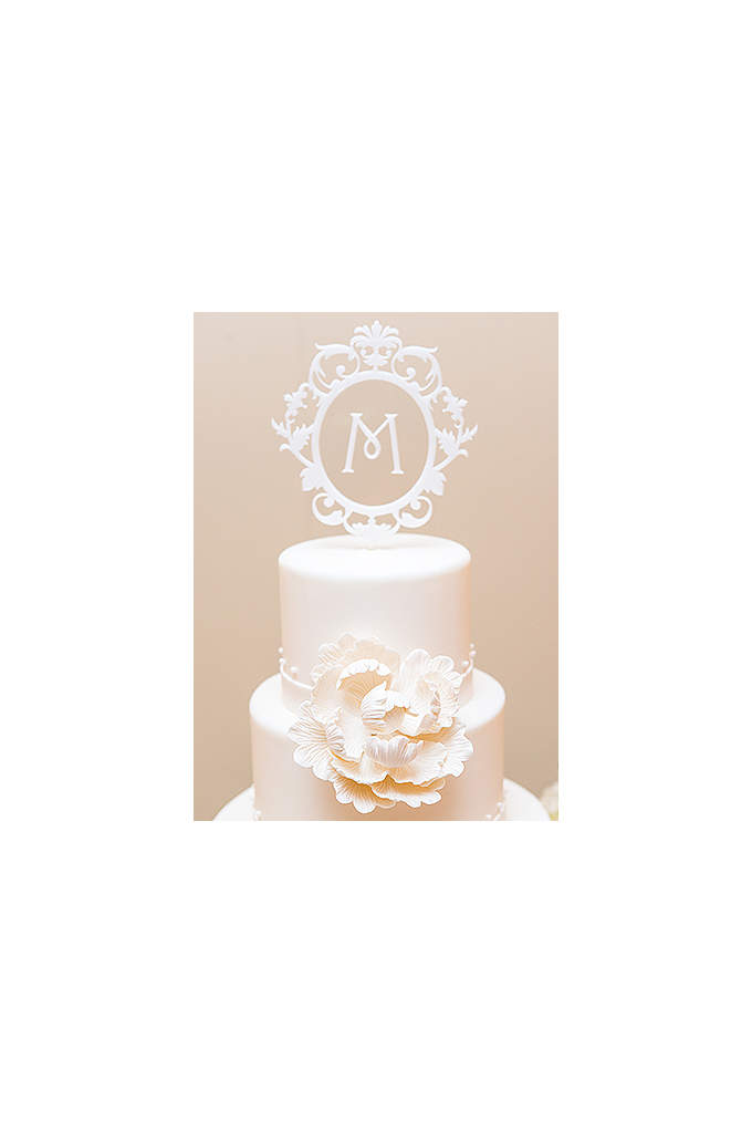 Personalized Floating Monogram Cake Topper - This cake topper features intricate details and is