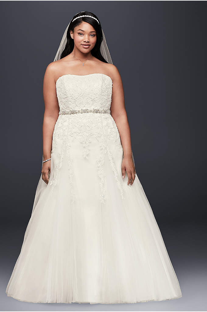 A-Line Beaded Tulle Plus Size Wedding Dress - This romantic wedding gown is truly a vision.