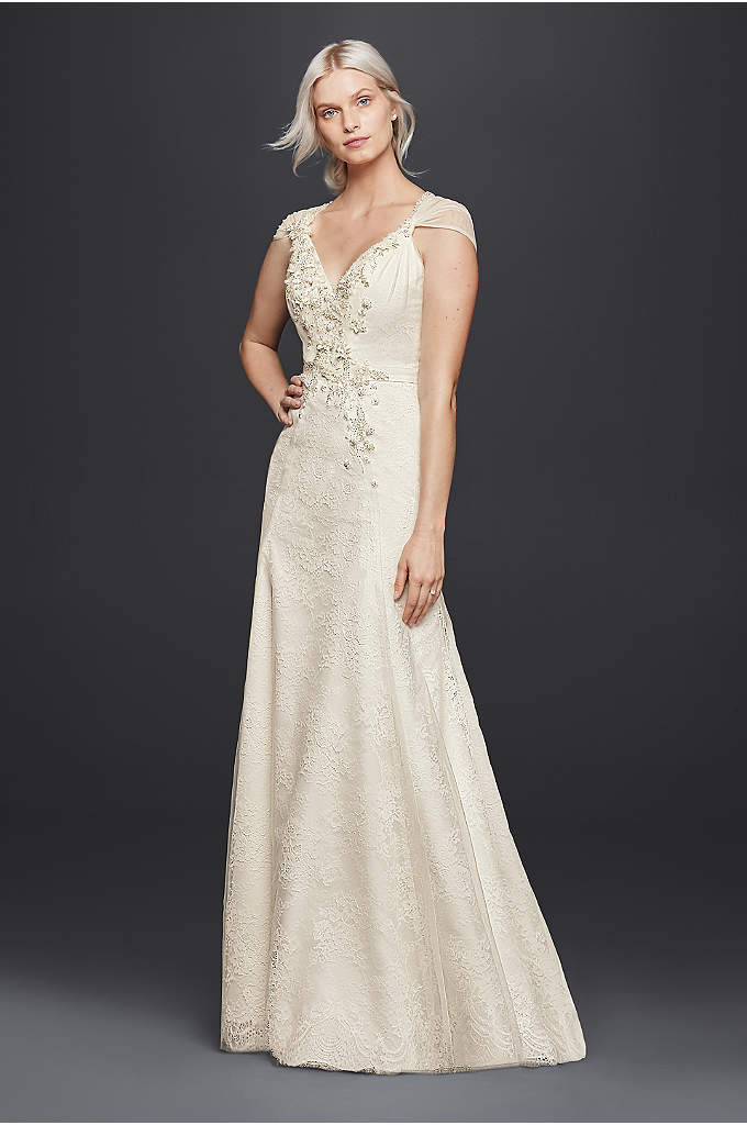 As-Is V-Neck Wedding Dress with Floral Applique - Light and airy, this sheath wedding dress will