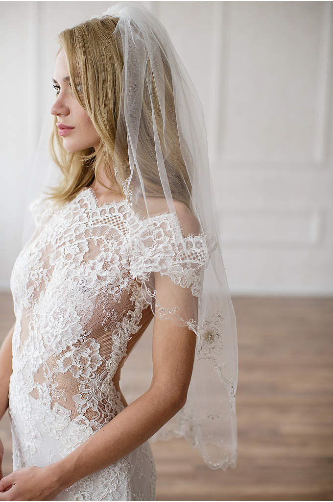 Hand-Sewn Beaded Floral Fingertip Veil - This tulle veil features hand-sewn crystal and bead