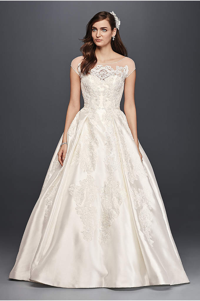 Oleg Cassini Illusion Cap Sleeve Wedding Dress - Royalty. That's what you'll exude in this elegant,