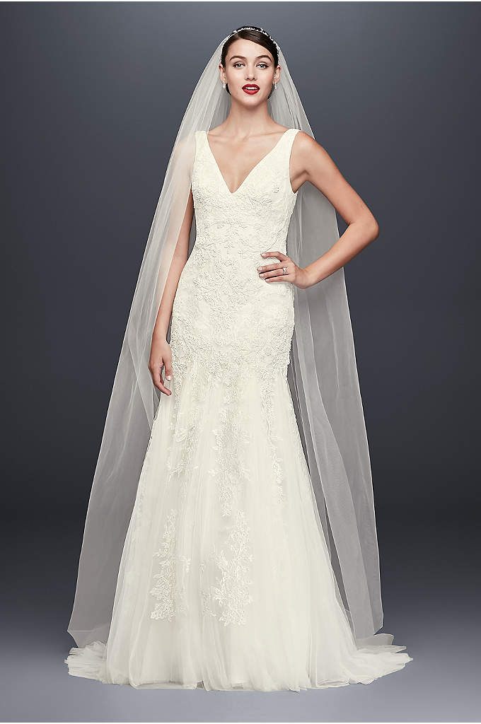 Pearl-Beaded V-Neck Mermaid Wedding Dress - An opulent Oleg Cassini creation, this lace-appliqued tulle