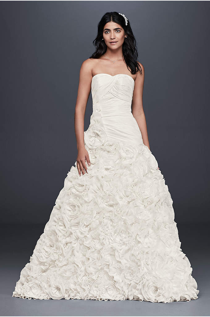 Rosette Skirt Wedding Dress - An intricately pleated, drop-waist gown with a grand