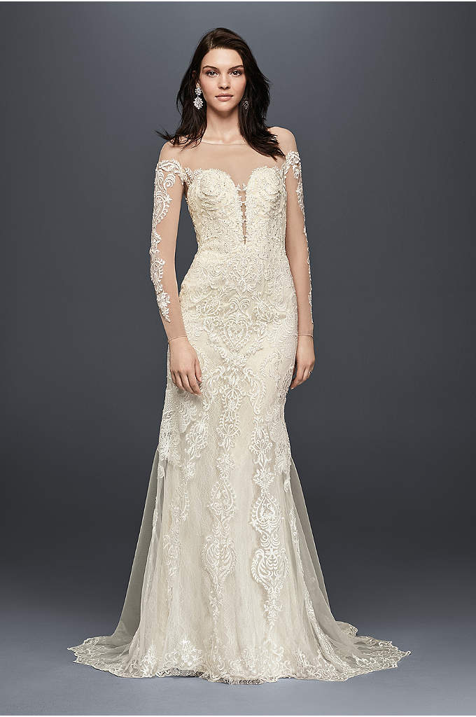 Long Sleeve Illusion Lace Wedding Dress - Crafted of appliqued lace and featuring a dramatic,