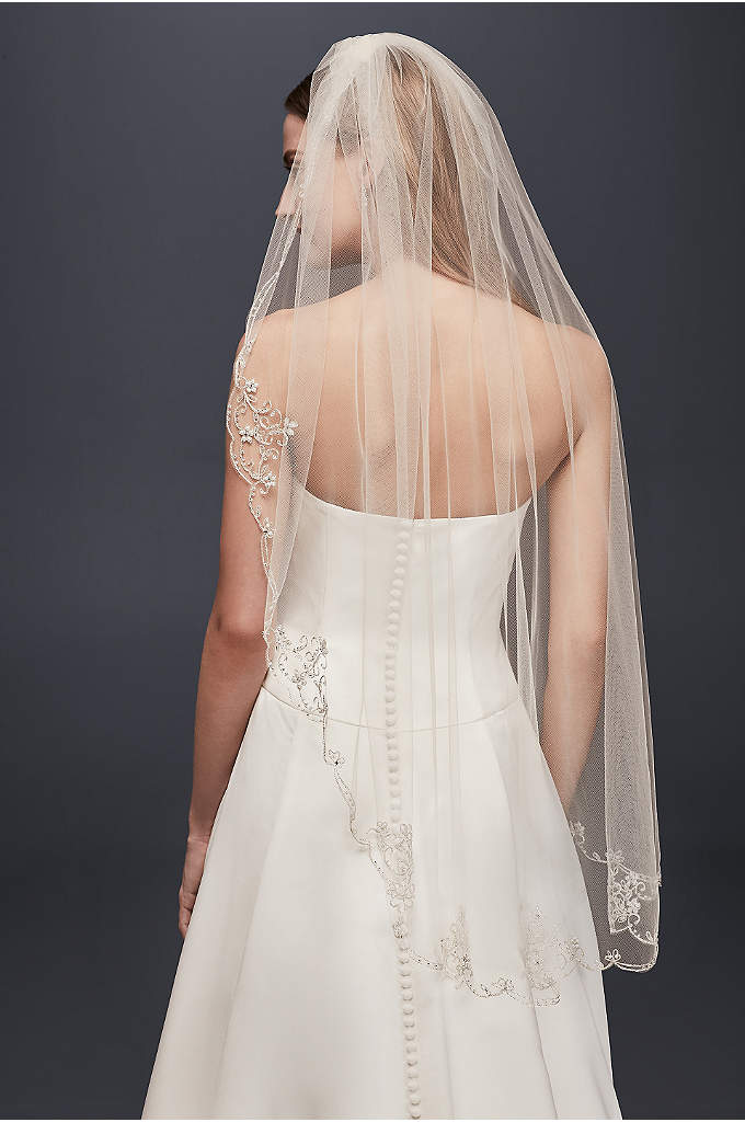 Scrolled Scallop-Edge Fingertip Veil - A delicate finish to your wedding dress, this