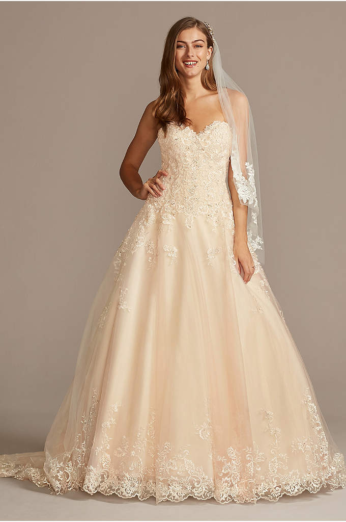 Beaded Lace and Tulle Ball Gown Wedding Dress - This romantic ball gown features beaded lace appliques