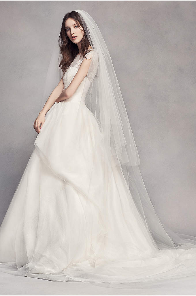 Wedding Dress and Veil from Davids Bridal - is a beautiful white, full-length, halter-style dress, with beaded side panel of fabric pulled across the front of dress and joined at side.