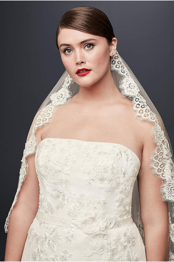 Mid Veil with Trailing Lace - This delicate veil features elegant lace accents paying