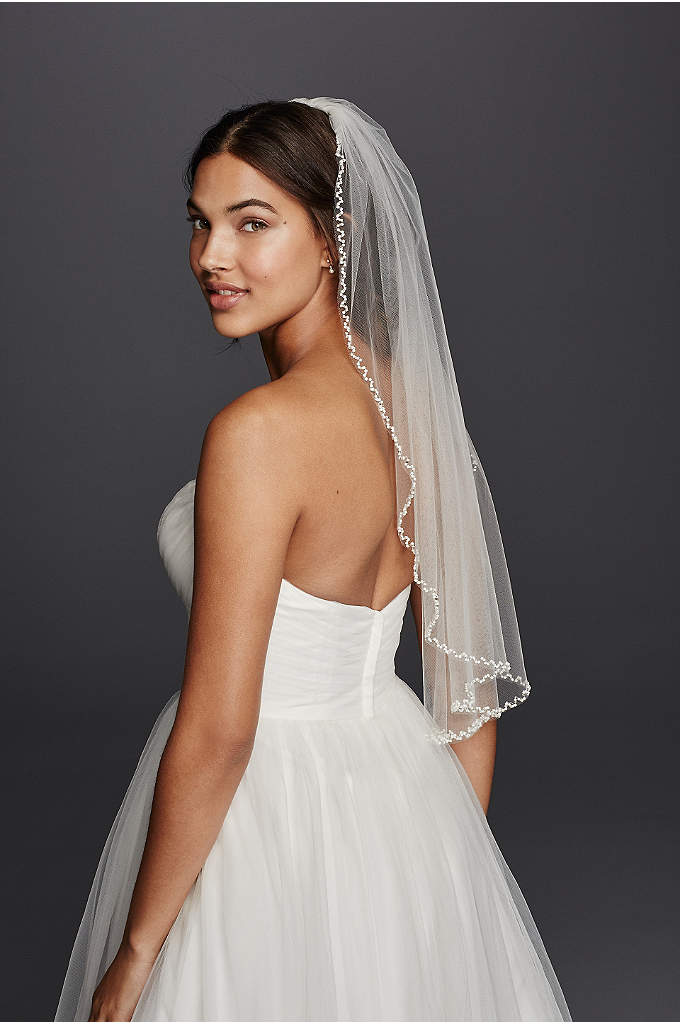 One Tier Beaded Edge Mid Length Veil - This one tier, elbow-length veil is gorgeously trimmed