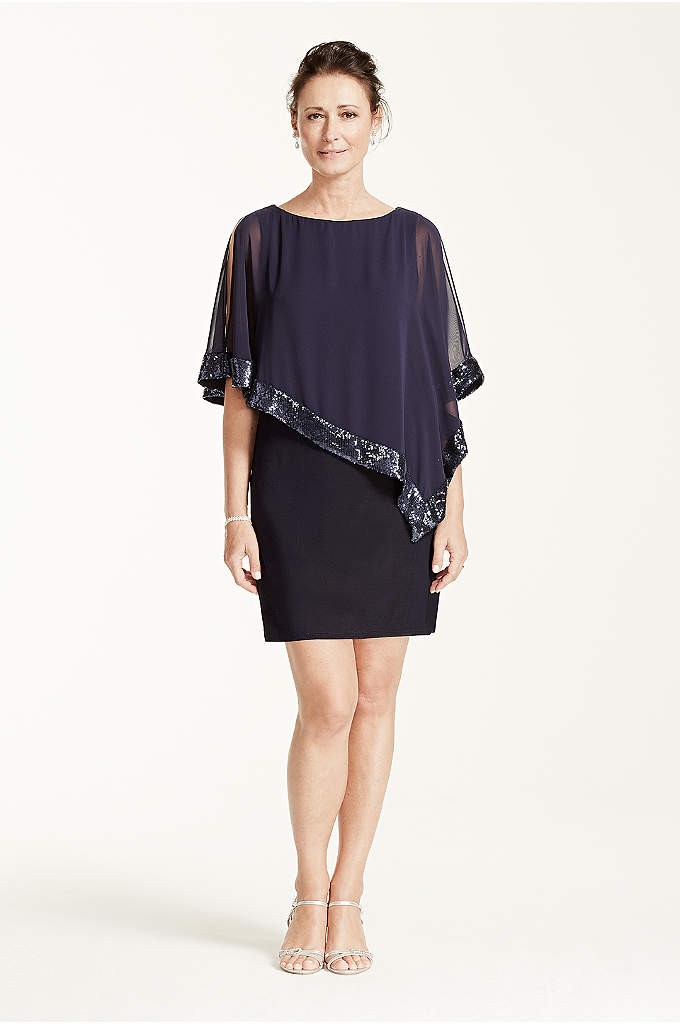 Short Jersey Dress with Sequin Trim Capelet - This short jersey dress with caplet overlay is