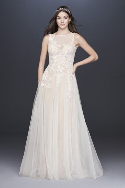 A-line wedding dress features layers of transparent tulle for a dreamy, floaty feel