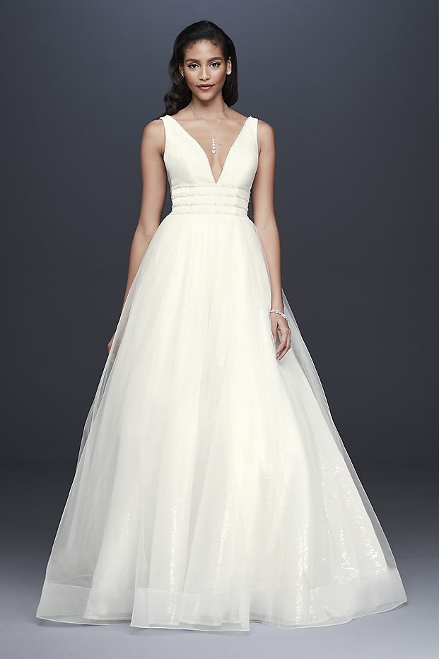 Soft tulle floats above an allover sequin underskirt