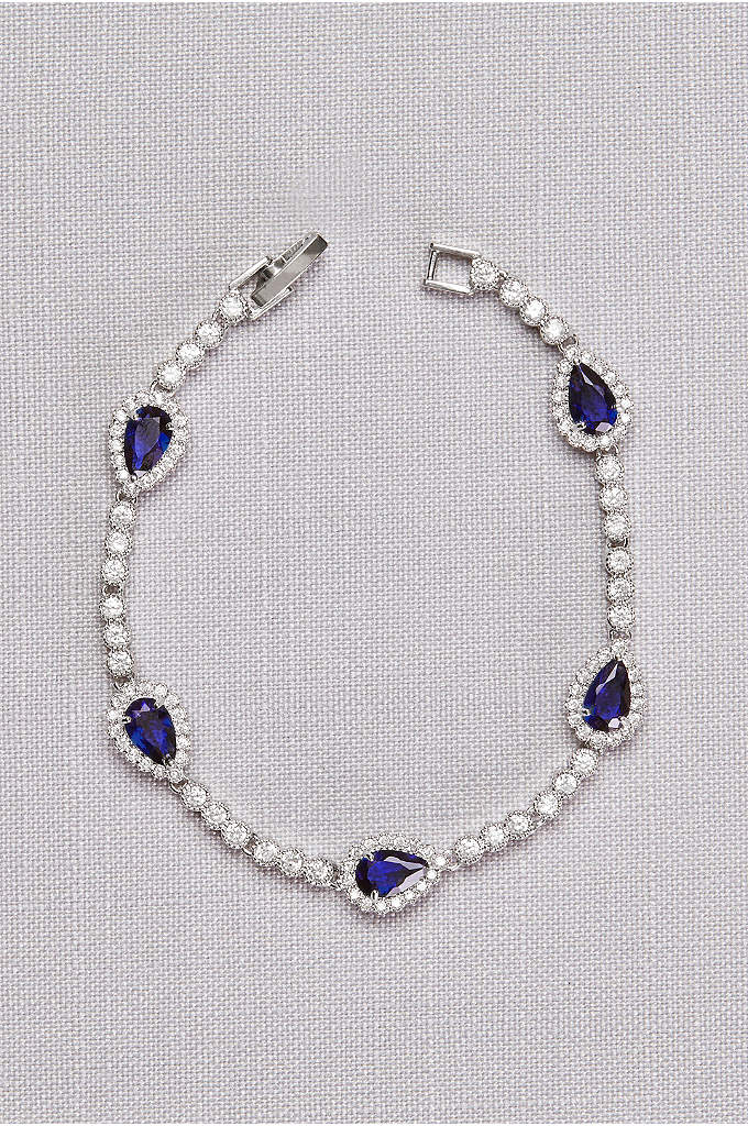 Pear Sapphire Cubic Zirconia Bracelet - This timeless tennis bracelet features brilliantly blue pear-shaped