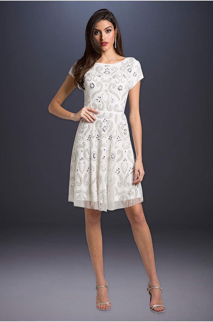 Lara Allison Short Sleeve Beaded Cocktail Dress - Topped with brilliant beadwork and finished with a