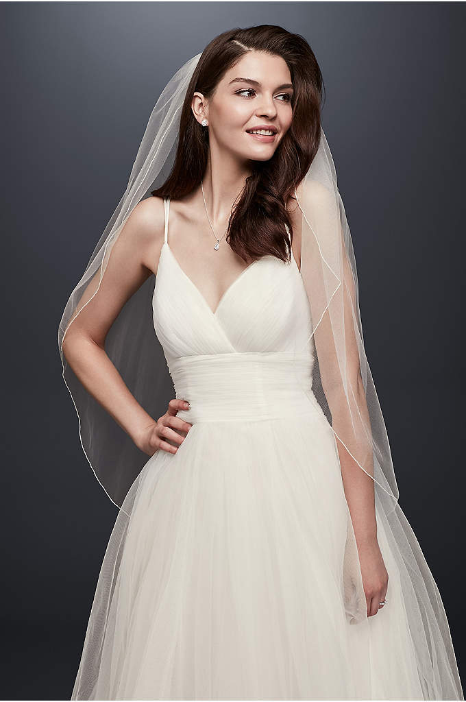 One Tier Tulle Fingertip Veil with Pencil Edge - This simple tulle fingertip-length veil is accented with
