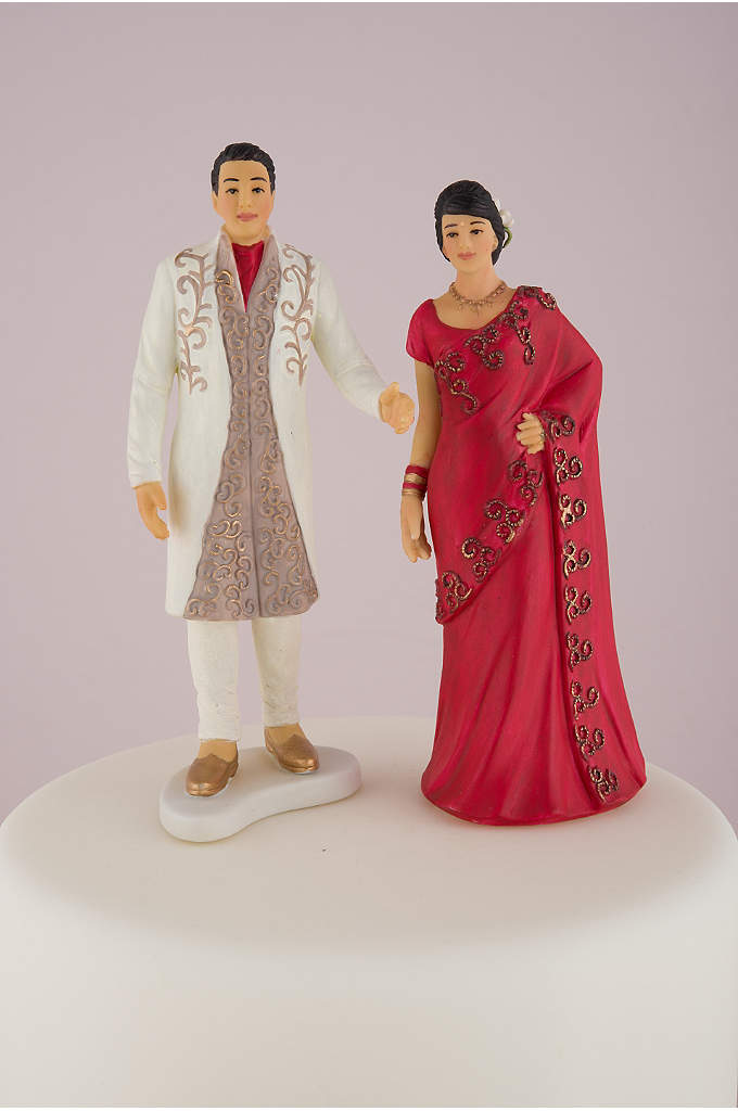 Traditional Indian Bride and Groom - Bedecked in a beautiful and ornate red sari,