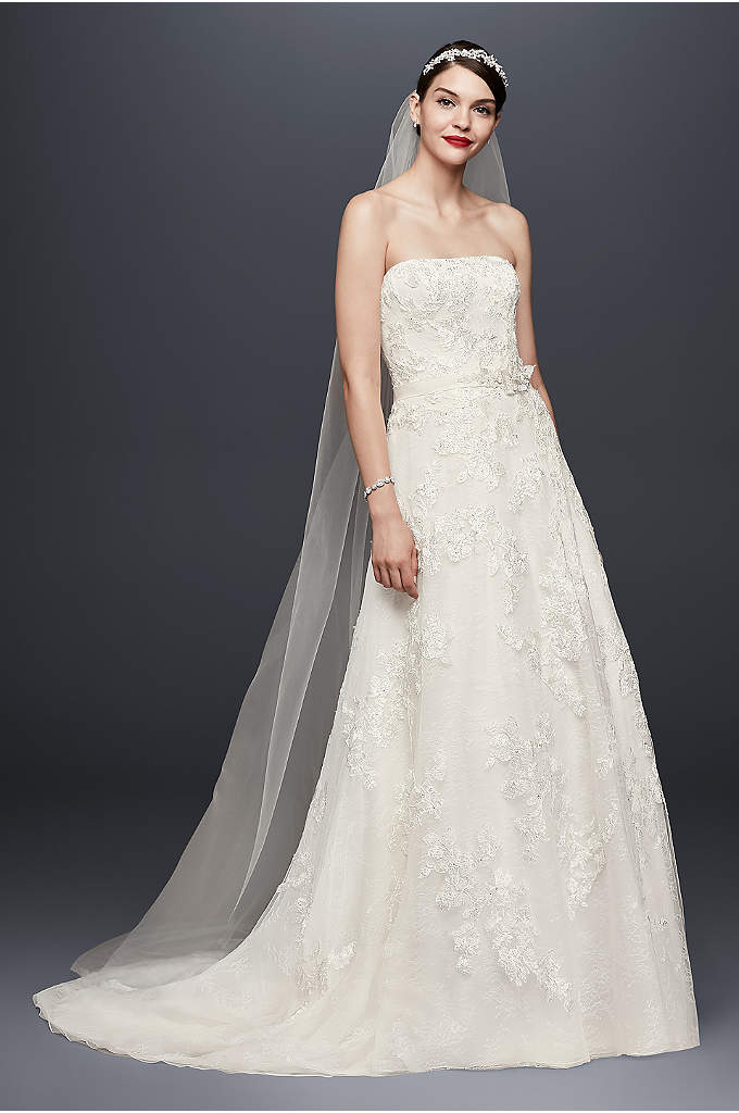 As-Is A-Line Wedding Dress with Lace Topper - This embellished strapless A-line wedding gown features a
