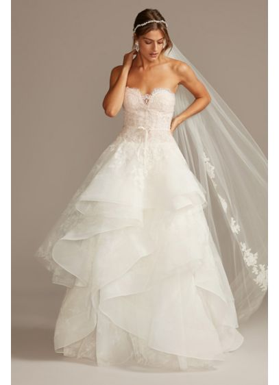 As Is Tulle Wedding Dress with Tiered Skirt - This floral-printed tulle ball gown wedding dress, appliqued