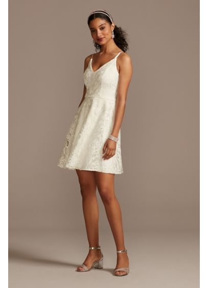 Embroidered Glitter Damask V-Neck Mini Dress - This spaghetti strap mini dress pairs a traditional