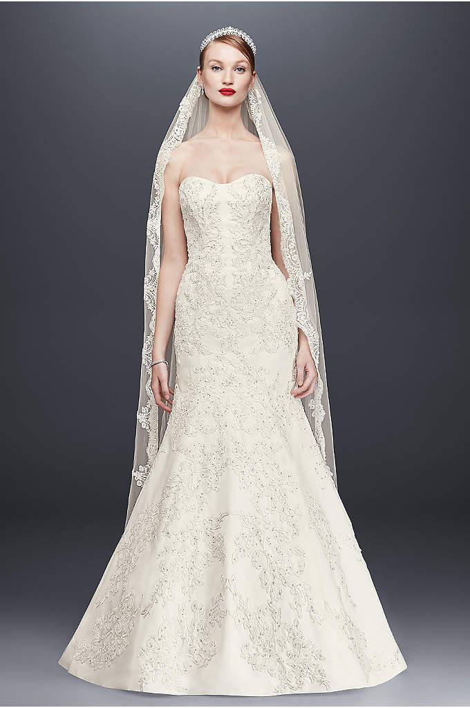 Oleg Cassini Satin Lace Strapless Wedding Dress - This satin strapless sweetheart trumpet gown is beautifully