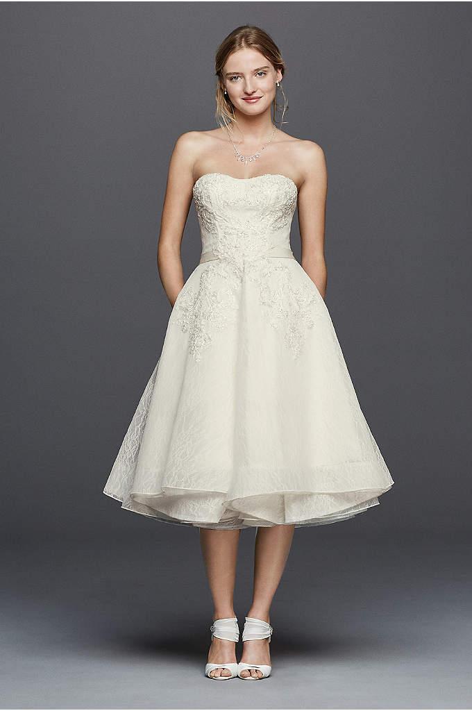 Oleg Cassini Short Strapless Lace Wedding Dress - A tea-length dress with a flirty pleated skirt