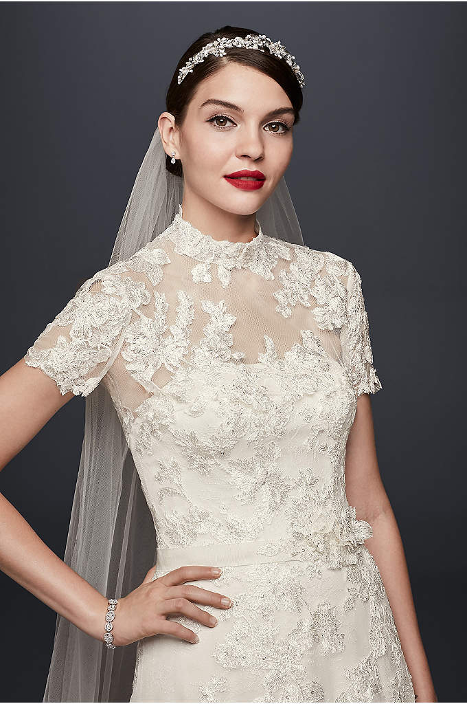 Lace Appliqued A-Line Wedding Dress and Topper - This embellished strapless A-line wedding gown from Oleg