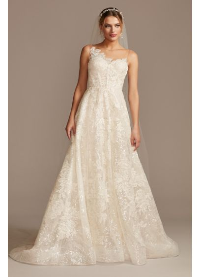 Applique Wedding Dress with Crystal Button Back - This corseted wedding dress features a luxurious lace