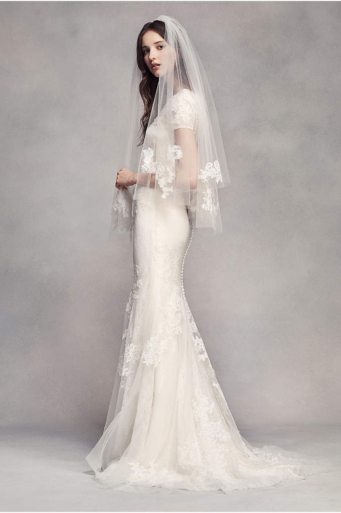 Fingertip Veil with Lace Appliques - On this elegant fingertip length veil, airy tulle