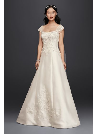The Oversize Liques That Grace A Line Bodice And Hem Of This Regal Mikado Wedding Dress Complement S Ultra Feminine Lace