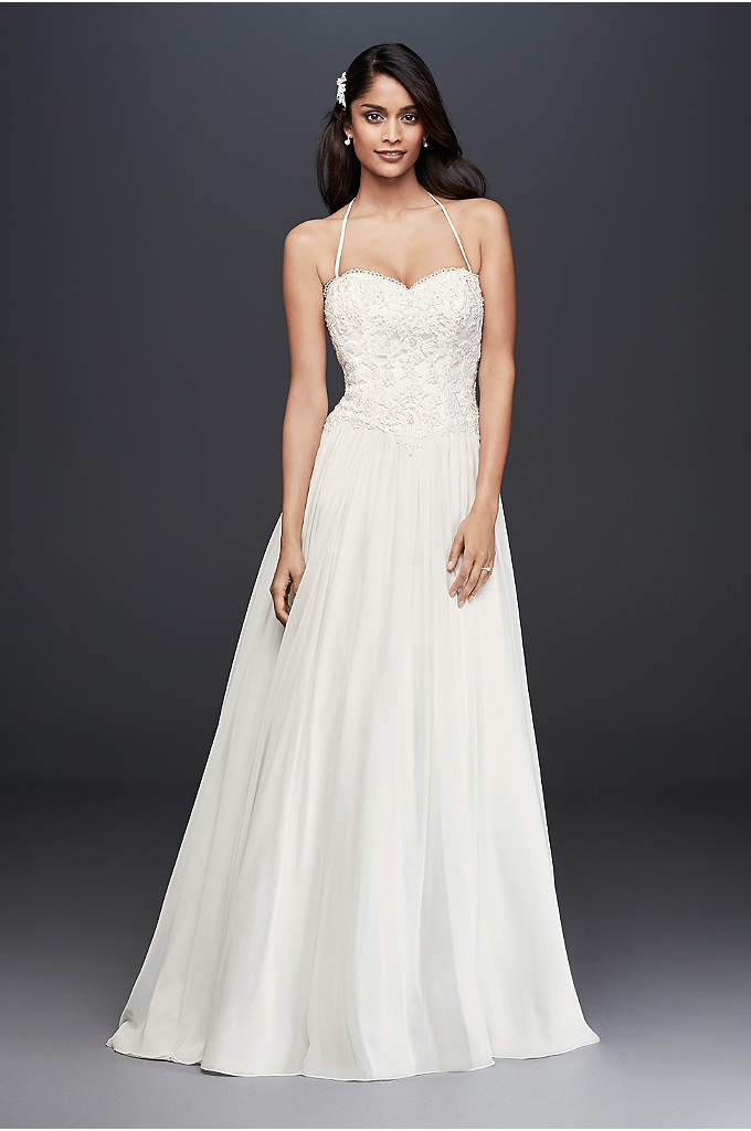 Basque-Waist Lace and Chiffon Wedding Dress - Appliqued with pearl- and crystal-encrusted lace, this classic,