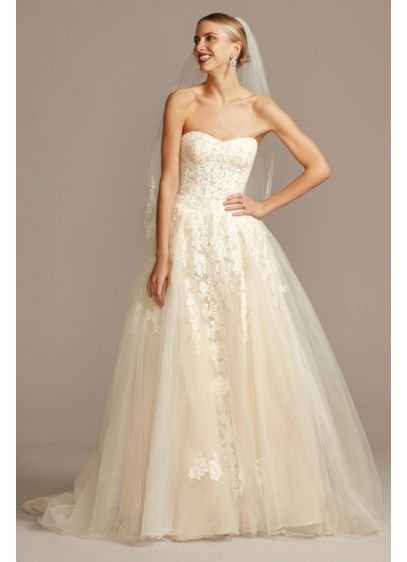 Sheer Lace and Tulle Ball Gown Wedding Dress - Delightfully alluring, the lace-appliqued, semi-sheer bodice of this