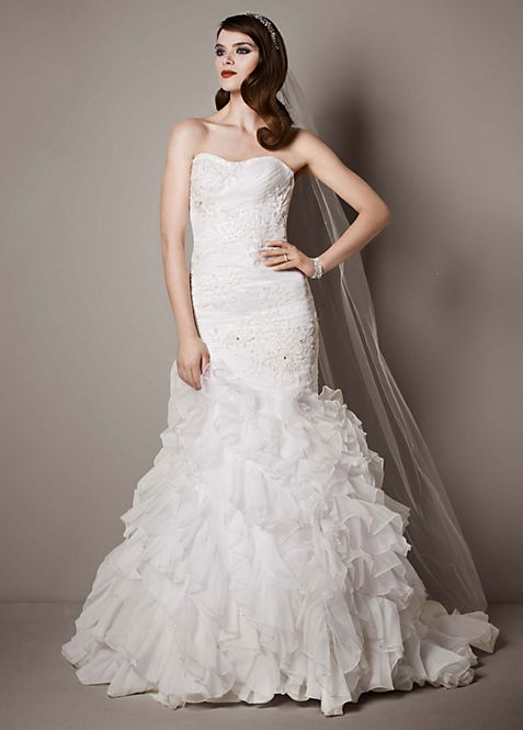 Wedding Gown With Lace Appliques And Ruffled Skirt